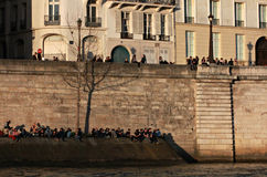 People Sit along the Seine, Paris, France Royalty Free Stock Images