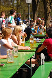 People sit in a beergarden. In a park in Munich,Germany Stock Photos