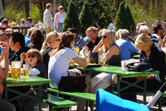 People sit in a beergarden. In a park in Munich,Germany Royalty Free Stock Photos