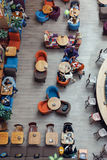 People sit at caf� tables. The view from the top. Royalty Free Stock Image