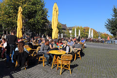 People sit at a cafe in Amsterdam, Holland Royalty Free Stock Photo