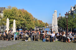 People sit at a cafe in Amsterdam, Holland Stock Photos