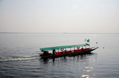 People sit and drive long tail boat go to Donsawan island Stock Photo