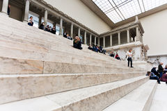 People sit on steps in Hall of Pergamon museum Royalty Free Stock Photography