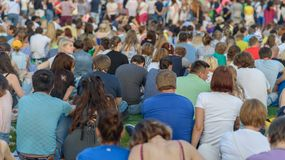 People sits at grass. Stock Images