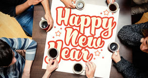 People sitting around table drinking coffee against new year graphic Royalty Free Stock Photos