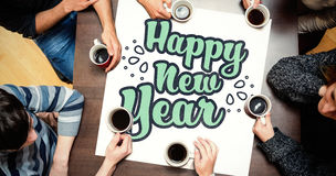 People sitting around table drinking coffee against new year graphic Stock Photography
