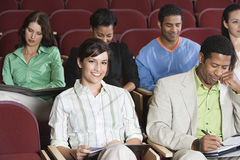People Sitting In Auditorium Royalty Free Stock Images