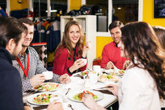 People sitting at the banquet table Stock Images