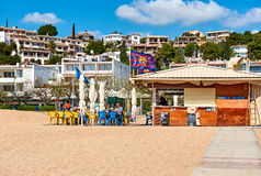 People sitting in a beach cafe of Tossa del Mar royalty free stock photo