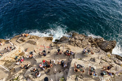 People sitting at the Buza Bar in Dubrovnik Royalty Free Stock Photo