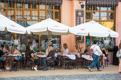 People are sitting in cafe on the Andriyivskyy Descent. Ukraine, Kyiv, Podil. Ed. People are sitting in cafe on the Andriyivskyy Descent, pedestrian street in Royalty Free Stock Photo