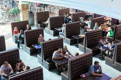 People is sitting in a cafe in shopping mall Royalty Free Stock Images