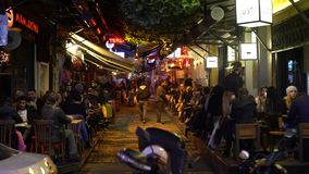 People sitting in cafes around very popular Besiktas region in Istanbul. Besiktas, Istanbul - December 2017: people sitting in cafes around very popular stock video
