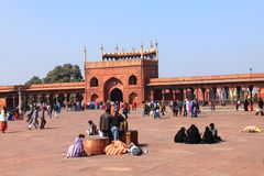 People sitting in the campus of Jama Masjid/Mosque Stock Images