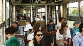 People sitting in car of city train moving rapidly along open air rail at day. Stock footage stock video