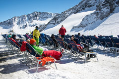 People sitting on chair in ski resort Stock Images