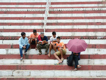 People sitting and chatting on street in Varanasi, India Stock Photography