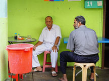 People sitting at the coffee shop in Penang, Malaysia Stock Photos