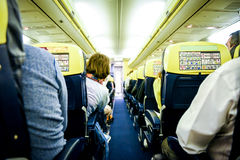 People sitting in commercial aircraft. Stock Photography