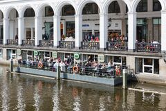 People sitting at floating terrace  in Hamburg, Germany Royalty Free Stock Photo