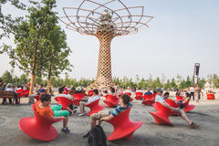 People sitting  in front of Tree of Life at Expo 2015 in Milan, Stock Photo