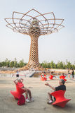 People sitting  in front of Tree of Life at Expo 2015 in Milan, Royalty Free Stock Photos