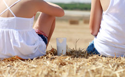 People sitting on hay Royalty Free Stock Images