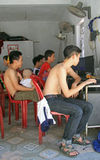 People are sitting in internet cafe Stock Images