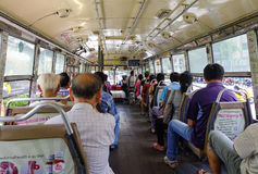 People sitting on the local bus in Bangkok, Thailand Stock Photos