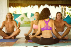 People sitting in lotus position Stock Photography