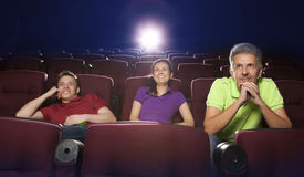People sitting in movie theater Stock Photography