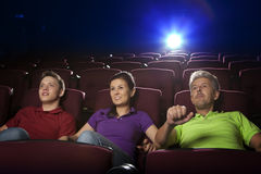 People sitting in movie theater Stock Images
