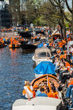 People sitting near the canal - Koninginnedag 2012 Stock Image