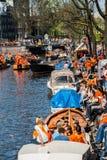 People Sitting Near The Canal - Koninginnedag 2012 Stock Image