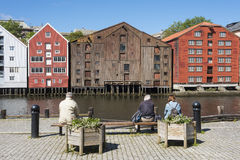 People sitting by Nidelv river Trondheim Royalty Free Stock Image