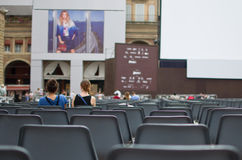 People sitting at an outdoor cinema Stock Photos