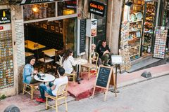 Istanbul, June 15, 2017: People sitting outside Galata Kofte restaurant. A popular place among tourists and local people. People sitting outside Galata Kofte Royalty Free Stock Images