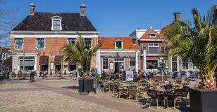 People sitting outside on the market square in Workum Stock Images