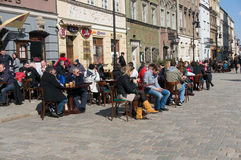 People sitting outside. A restaurant on a spring day in Poznan, Poland Royalty Free Stock Photos