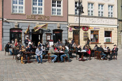 People sitting outside. A restaurant on a spring day in Poznan, Poland Royalty Free Stock Images