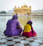 People sitting and praying at the Golden temple in Amritsar Royalty Free Stock Photography