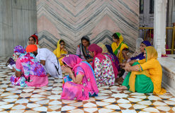 People sitting and praying at Golden temple in Amritsar, India Stock Images