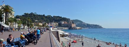 People sitting on the Promenade Des Anglais, Nice, France royalty free stock images