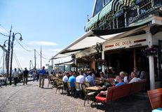 People sitting at quayside restaurant, Volendam stock photo