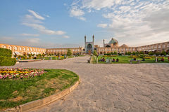 People sitting and relaxing on the green grass of famouse Imam Square. ISFAHAN, IRAN: People sitting and relaxing on the green grass of famouse Imam Square Stock Photography