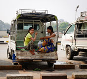 People sitting in the small bus in Mandalay, Myanmar Stock Images