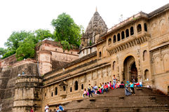 People sitting on stairs of Ahilya fort with the walls Royalty Free Stock Photography
