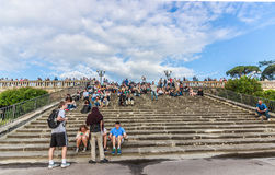 People sitting on the stairs at Piazza Michelangelo Florence Italy. Taking selfies with mobile phones Stock Photos