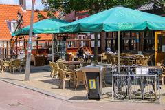 People sitting in a street cafe in Zandvoort, the Netherlands. Royalty Free Stock Photos